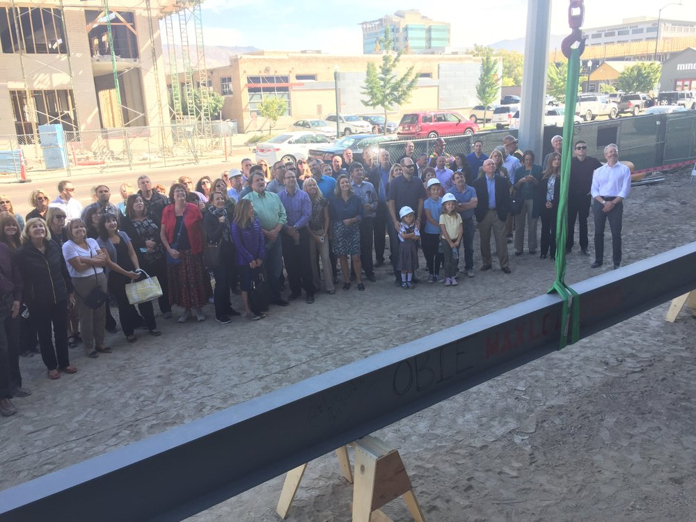 Crowd poses for a picture before the beam was lifted into place