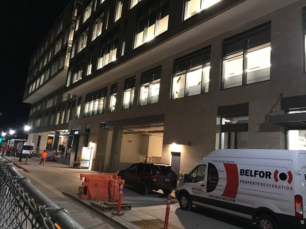 Disaster recovery workers at the Simplot HQ building Friday night