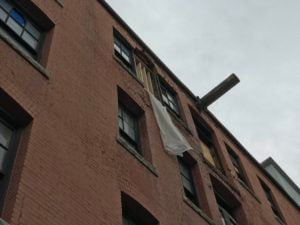 Bricks tumble off Bouquet building, forcing alley closure
