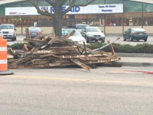 Old trolley tracks unearthed during downtown road work