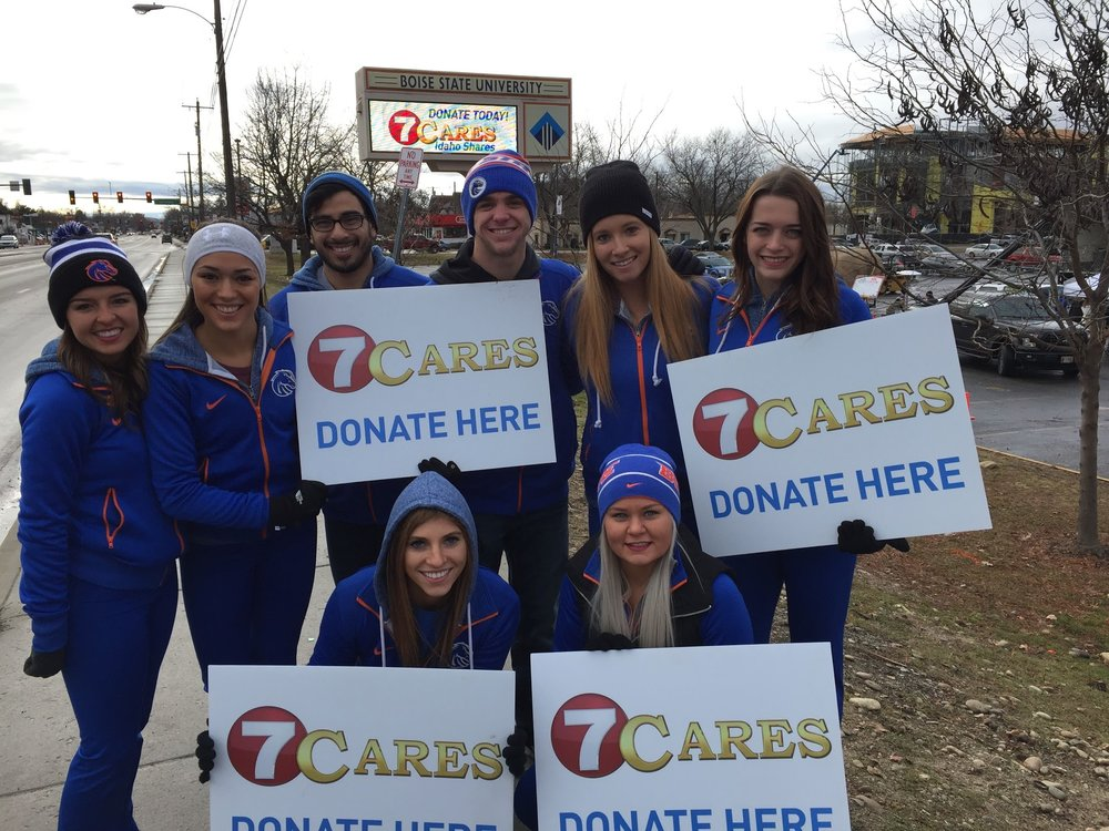 Members of the Boise State Spirit Squad pose in front of the sign in December, 2015 - just shortly before it was turned off in time for reconstruction of the Broadway Bridge.