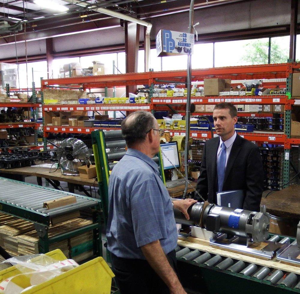 California State Senator Mike McGuire visits with Price Pump President Bob Piazza in Sonoma in 2016. Courtesy Price Pump