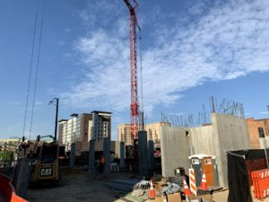 Going up: After delay, downtown apartment project begins to rise